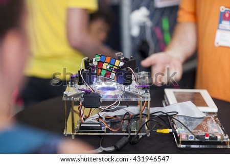 SAN MATEO, CA May 20 2016 - A demonstration of a Rubik's Cube solving machine during the 11th annual Bay Area Maker Faire at the San Mateo County Event Center. - stock photo