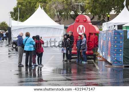 SAN MATEO, CA May 20 2016 - Attendees snap a group photo during the 11th annual Bay Area Maker Faire at the San Mateo County Event Center. - stock photo