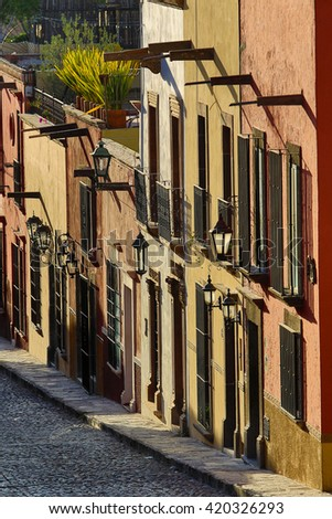 San Miguel de Allende street-scape in the afternoon sun - stock photo