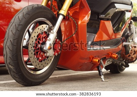 San Pablo City, Laguna, Philippines - September 12, 2015: close up of  big motorcycle front wheel, focus tyre - stock photo