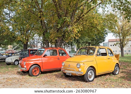 """SAN PANCRAZIO, RA, ITALY - OCTOBER 13: vintage italian cars Fiat 500 parked under a tree during the classic car rally at the festival """"Sagra paesana"""" on October 13, 2013 in San Pancrazio, RA, Italy  - stock photo"""