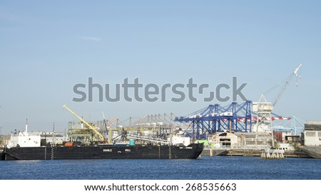 SAN PEDRO, CA - APRIL 08, 2015: Double Hull Non-Powered Barge DAVID FANNING docked at the Port of Los Angeles. - stock photo