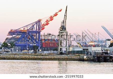 SAN PEDRO/CALIFORNIA - FEBRUARY 8, 2015: Los Angeles Harbor shipyard cranes and containers. A leading seaport in North America. February 8, 2015 San Pedro, California USA  - stock photo