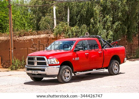 SAN PEDRO DE ATACAMA, CHILE - NOVEMBER 15, 2015: Red pickup truck Dodge Ram 2500 at the countryside. - stock photo