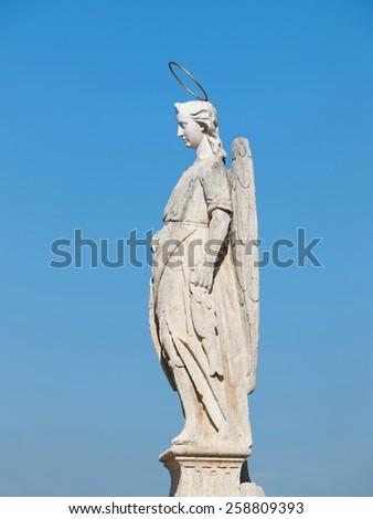San Rafael statue of the Roman bridge - Cordoba, Andalusia, Spain  - stock photo