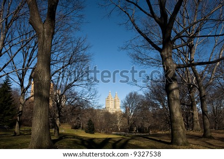 San Remo residential building surrounded by the trees of Central Park - stock photo