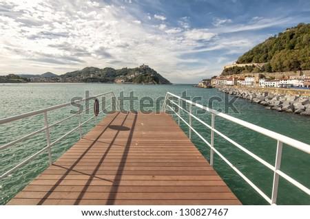 San Sebastian, Spain. Santa Clara Island and Igueldo Castle in background. - stock photo