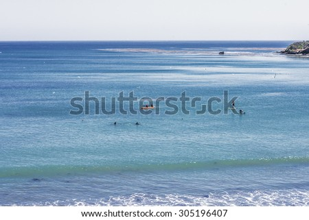 San Simeon Bay, Pier & Hearst Memorial State Beach, people kayaking in the water, with Bottlenose dolphins located on the rugged Big Sur coastline, near Cambria, CA. on the California Central Coast. - stock photo