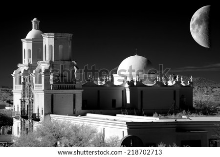 San Xavier Mission and moon in black and white - stock photo
