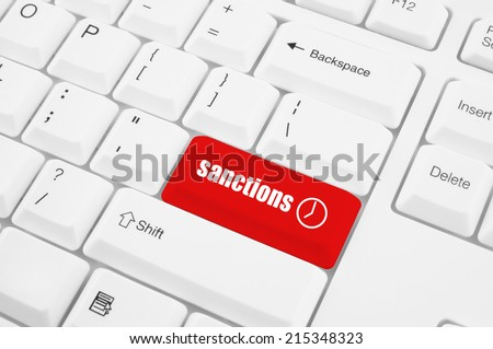 Sanctions button on white keyboard  - stock photo