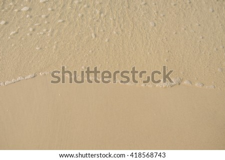 sand and sea wave background. - stock photo