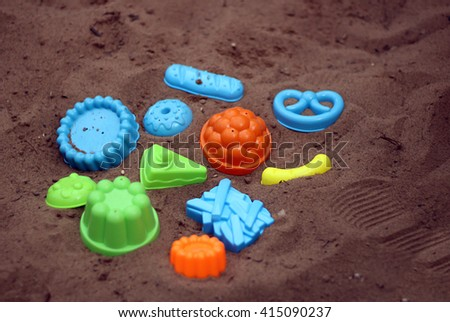 sand and toy - stock photo