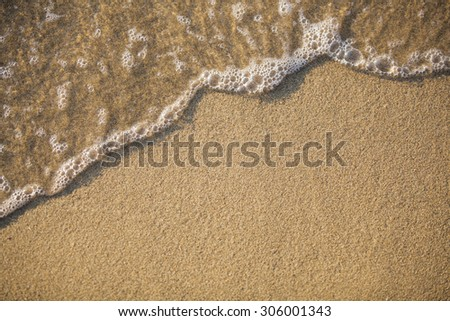 Sand and water - stock photo