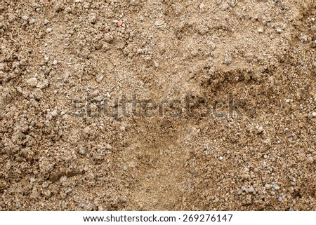 Sand background texture. Close-up of coarse sand grains. - stock photo