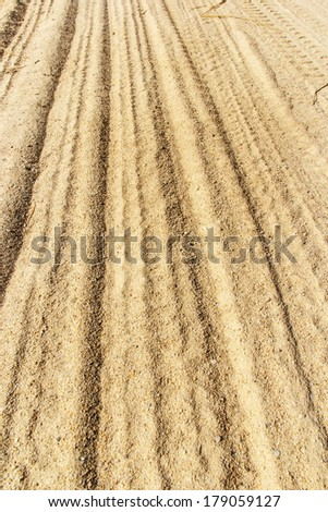 sand backgrounds and texture, Wheel tracks in the sand backgrounds and texture . - stock photo