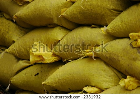 Sand Bags stacked up to divert flood waters - stock photo