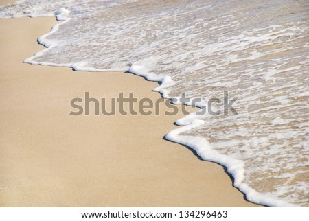 Sand beach and sea wave background - stock photo