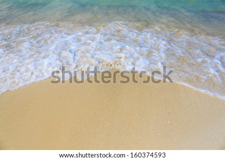 Sand beach and wave - stock photo