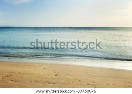 sand beach and waves of thai Sea - stock photo