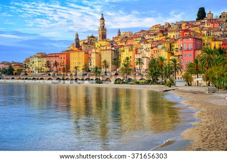 Sand beach beneath the colorful old town Menton on french Riviera, France - stock photo