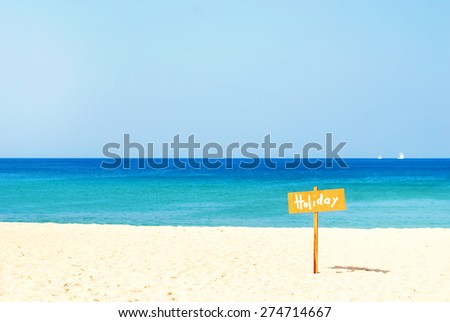 Sand Beach with Water Line, Sky and Label. Nature background - stock photo