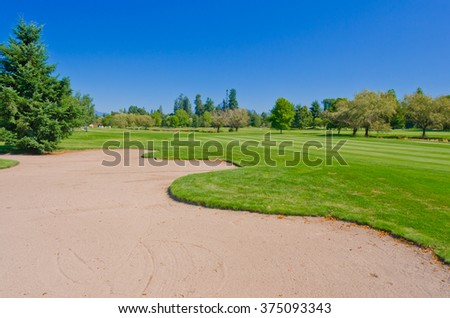 Sand bunker at the beautiful golf course. - stock photo