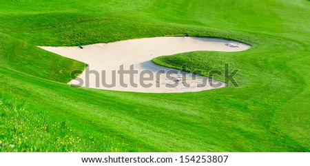Sand bunker on the golf field - stock photo