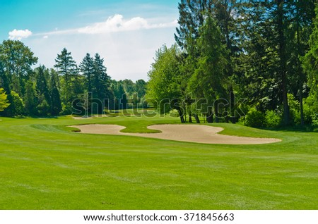 Sand bunkers at the beautiful golf course. - stock photo