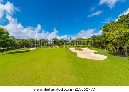 Sand bunkers on the beautiful golf course. Luxury Mexican resort. - stock photo