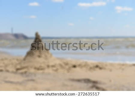 Sand castle at the beach on sunny day - stock photo