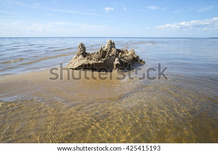 Sand castle built in the shallow waters of the Gulf of Finland - stock photo