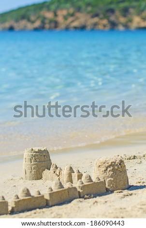 Sand castle on the beach. - stock photo