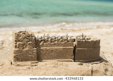 Sand castle on the beach. Concept holiday by the sea, playing with children, dreaming, vacation, enjoy the summer - stock photo