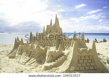 Sand castle on the picture perfect white sandy beach. Boracay, Philippines. - stock photo