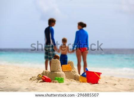sand castle on tropical beach, family vacation concept - stock photo
