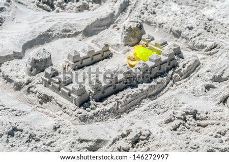 sand castle structures built at seashore beach - stock photo