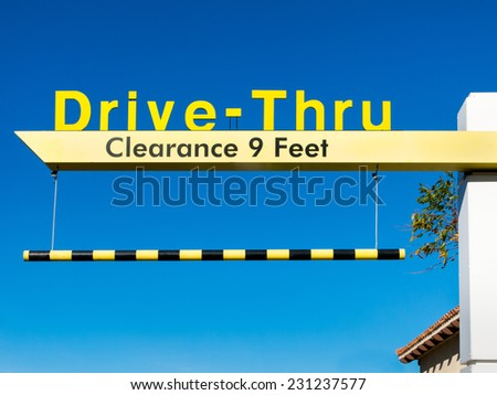 SAND CITY, CA/USA - NOVEMBER 17, 2014: McDonald's Drive-Thru sign. The McDonald's Corporation is the world's largest chain of hamburger fast food restaurants. - stock photo