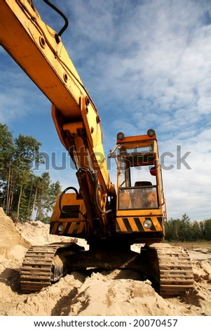 Sand digging in the woods. Open mining. - stock photo