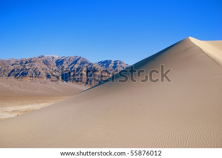 Sand Dune and Mountain - stock photo