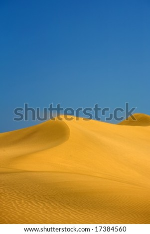 Sand Dune with Wind Textures in the Desert in Morocco - stock photo