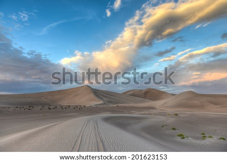 Sand Dunes along the Amargosa Desert at sunset. Located in Nye County in western Nevada, United States, along the California-????Nevada border - stock photo