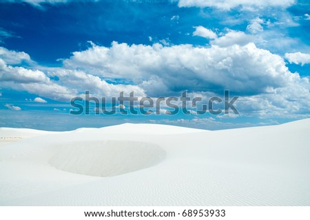 sand dunes and dynamic clouds - stock photo