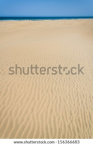 Sand dunes and ocean in southern Madagascar - stock photo