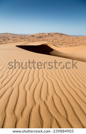 Sand dunes and waves in the sand. nobody, Vertical - stock photo
