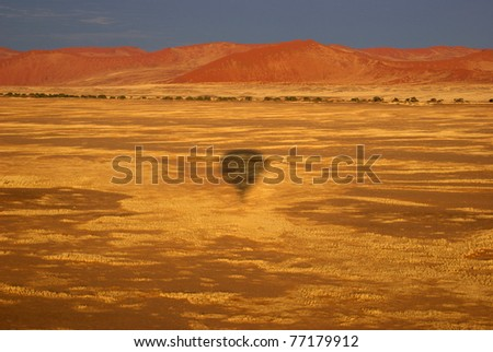 sand dunes from hot air balloon - stock photo