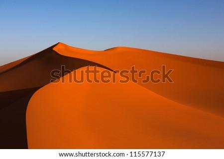 Sand dunes in the Sahara desert - stock photo