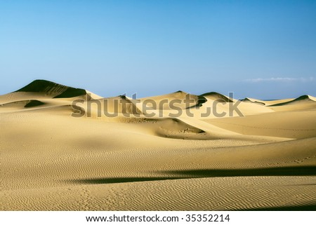 Sand dunes on the sunset - stock photo