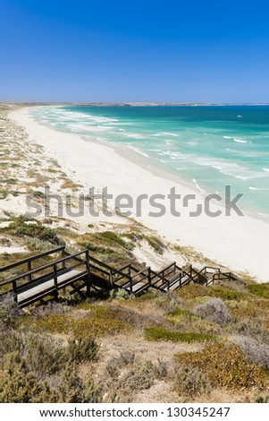 Sand dunes stretch into the distance along the coast - stock photo