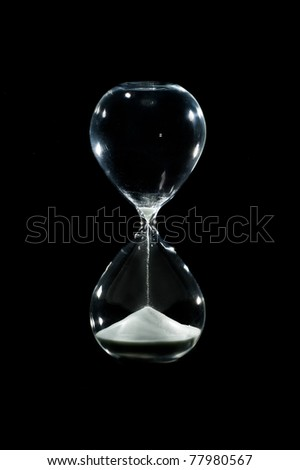 sand falling through an hour glass - stock photo