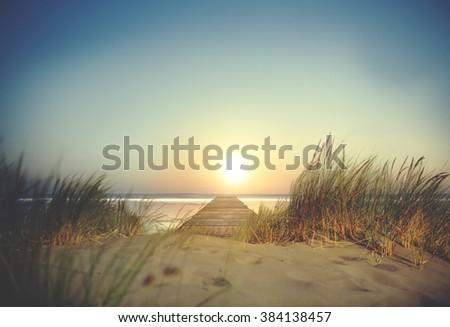 Sand Grass Beach Sun Sea Ocean Sky Trip Natural Concept - stock photo